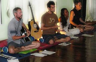 group of yogis doing plough posture