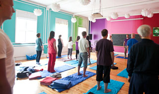 group of yogis doing cobra posture